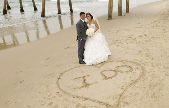 Ambra and Gil are photographed under the Hermosa Beach Pier in Hermosa Beach, CA on 8/24/13.