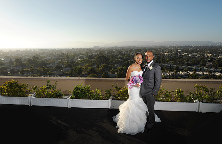 Whitney and Curtis are photographed on their wedding day on the roof top patio of the Marina Del Rey Marriott in Marina Del Rey, CA on 9/5/15.