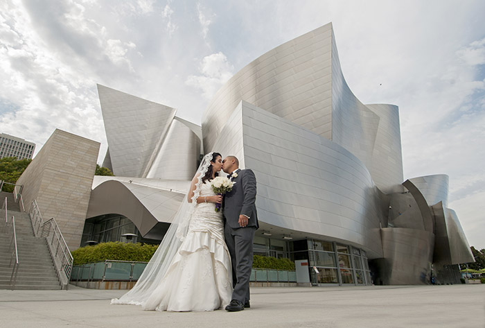 Daisy and Martin share a kiss on their wedding day in front of the Disney Concert Hall in Los Angeles, CA on June 27, 2015.